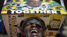 An ANC supporter cheers at pre-election rally on Sunday. (Ben Curtis/AP)