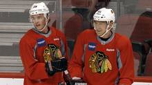 Chicago Blackhawks' Jonathan Toews (19) and Marian Hossa (81), of Slovakia, pause to chat during practice Wednesday, April 11, 2012, in Glendale, Ariz. The Blackhawks and the Phoenix Coyotes are scheduled to play Game 1 of an NHL hockey playoffs Western Conference opening-round series Thursday. (Ross D. Franklin/AP Photo)