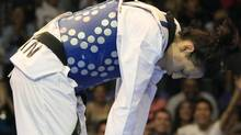 Canada's Melissa Pagnotta bows after winning the gold medal during the women's taekwondo -67 kg final match against Paige Mcpherson of The United States at the Pan American Games in Guadalajara, Mexico, Monday, Oct. 17, 2011. (AP Photo/Martin Mejia) (Martin Mejia)