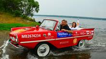 Jeff Norton driving the Amphicar onto the beach at Falcon Lake, Manitoba. (Alex Zimmer/Alex Zimmer.)