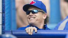 Toronto Blue Jays manager John Gibbons smiles back at the crowd during the second inning of their MLB baseball spring training game against the Boston Red Sox in Dunedin, Florida February 25, 2013. (FRED THORNHILL/REUTERS)