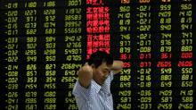 A Chinese investor in front of an electronic stock board at a brokerage house in Fuyang city in central China's Anhui province, Friday, Aug. 5, 2011. (AP/AP)