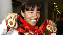 Canadian Paralympic athlete Chantal Petitclerc poses with the five gold medals she won at the Beijing Paralympic Games after arriving at Pearson International Airport in Toronto, September 18, 2008. (MIKE CASSESE/Mike Cassese/Reuters)