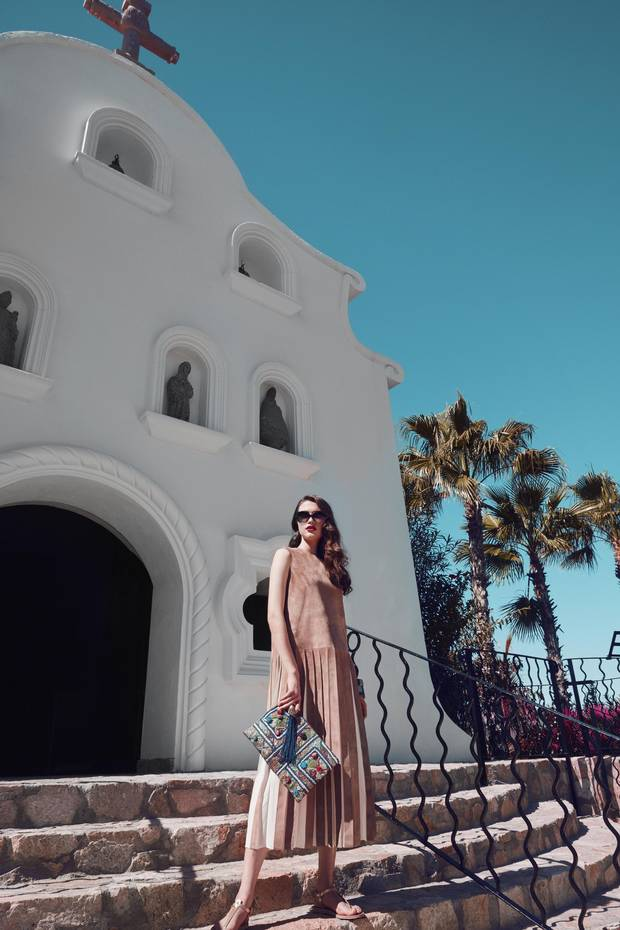 Built on the resort's highest point and visible all the way from San Jose del Cabo, the traditional on-site chapel is a popular spot for destination weddings. Dress, price on request at Hermès. Ancient Greek sandals, $219 (U.S.), Aboydbazaar bag, $236 (U.S.), Salvatore Ferragamo sunglasses, $296 (U.S.) at Neo One & Only Palmilla.
