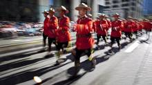 Members of the Royal Canadian Mounted Police march during the Calgary Stampede parade in Calgary, Friday, July 6, 2012. A senior RCMP officer in Alberta is facing sex charges in connection with an incident involving a 12-year-old girl more than three decades ago. (Jeff McIntosh/THE CANADIAN PRESS)