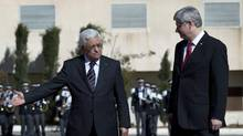 Palestinian President Mahmoud Abbas, left, receives Canadian Prime Minister Stephen Harper during a welcome ceremony at his headquarters, in the West Bank city of Ramallah, Monday, Jan. 20, 2014. (Nasser Nasser/AP)