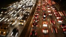 Car light trails are pictured as traffic jams along a main road in Sao Paulo. (PAULO WHITAKER/REUTERS)