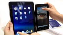 "People compare the performance of Apple's iPad (L) and Samsung's Galaxy Tab tablet devices at the Internationale Funkausstellung (IFA) consumer electronics fair at ""Messe Berlin"" exhibition centre in Berlin, September 2, 2010. (THOMAS PETER/THOMAS PETER/REUTERS)"