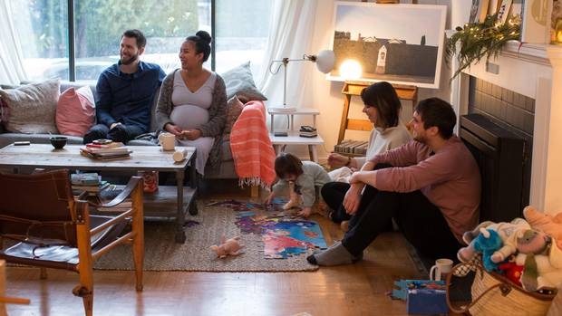 Conor and Veronica Lorimer talk with roommates Matt and Danielle Clarke and their daughter Frances, 2, at their home in Vancouver, British Columbia on December 28, 2016.