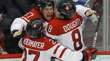 Canada's Sidney Crosby celebrates with teammates Scott Niedermayer, left, and Drew Doughty after scoring the game winning goal against the U.S. during overtime in their men's ice hockey gold medal game at the Vancouver 2010 Winter Olympics February 28, 2010. (Reuters)