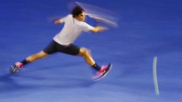 Roger Federer of Switzerland hits a return to Milos Raonic of Canada during their men's singles match at the Australian Open tennis tournament in Melbourne January 21, 2013. (DAVID GRAY/REUTERS)