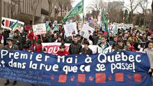 Students and workers walk to the legislature in a May Day protest Tuesday, May 1, 2012 in Quebec City. (Jacques Boissinot/THE CANADIAN PRESS)