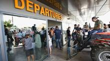 Greek farmers protesting proposed pension cuts block the 'departures' door at the Iraklio International Airport in Crete. Politicians who stick to harsh austerity measures could be shown the door too. (BASTIAN PARSCHAU/Associated Press)