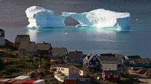An iceberg floats near a harbour in the town of Kulusuk, east Greenland. (BOB STRONG/Bob Strong/ Reuters)