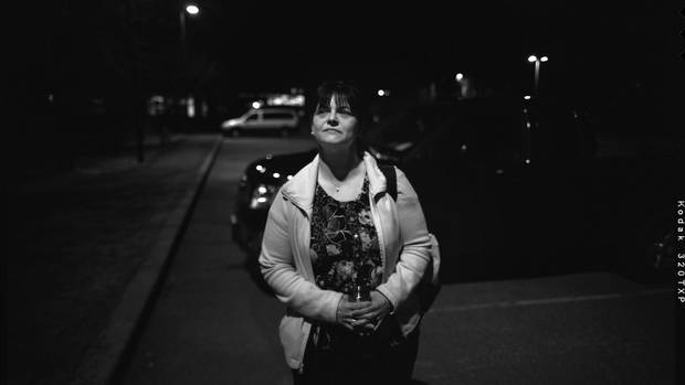 Trish Madigan, 44, is photographed in the parking lot of a seniors residence where she's about to begin her second shift of the day at 11 p.m.