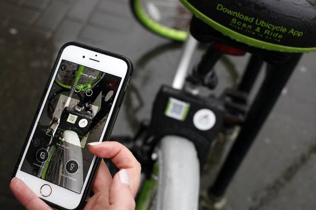 Riders find the nearest bike by using a map on an app, and unlock it with their phones. Riders typically pay $1 a half-hour or a ride.