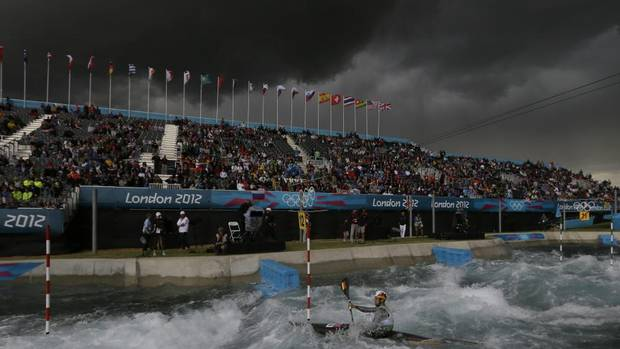 The sky turns black before a heavy rain shower as Germany's Hannes Aigner competes in the heats of the K-1 men's canoe slalom at Lee Valley Whitewater Center. (Kirsty Wigglesworth/AP)