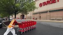 A Target employee returns carts to the store in Falls Church, Va. (KEVIN LAMARQUE/REUTERS)