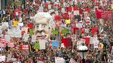 Students carry an effigy of Quebec Premier Jean Charest as they march through the streets of downtown in a massive protest against tuition fee hikes Thursday, March 22, 2012 in Montreal. (Ryan Remiorz/THE CANADIAN PRESS/Ryan Remiorz/THE CANADIAN PRESS)