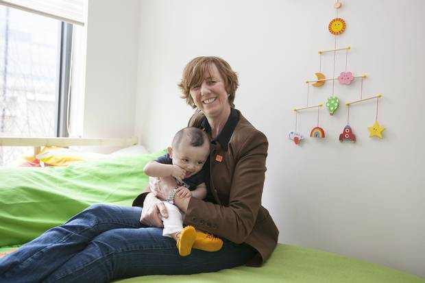 April 8, 2016: Martine Roy hold her baby girl, Cascia Roy-Paul at home in Montreal. Ms. Roy was forced out of the Canadian military when her superiors found out she was gay.
