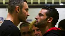 WBC Heavyweight boxing champion Vitali Klitschko of Ukraine, left, and Manuel Charr of Germany face each other during the weigh-in in Moscow, Russia, Friday, Sept. 7, 2012. The opponents will compete for the WBC heavyweight title in Moscow on Sept. 8. (Alexander Zemlianichenko/AP)