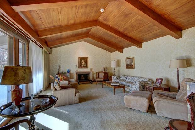 The formal living room with chevron ceiling beams.