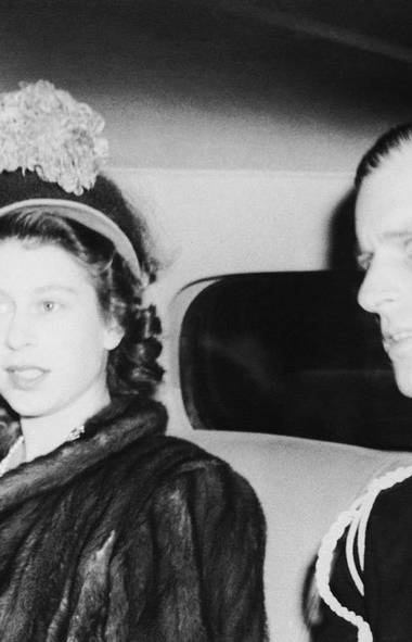 Here, Queen Elizabeth (then known as Princess Elizabeth) leaves Londonderry House on October 20, 1948 in London after attending the wedding and reception of Lady Margaret Egerton and John Rupert Colville (not shown is her husband, Philip, Duke of Edinburgh, seated next to her in the car). The wedding and reception marked Elizabeth's last public appearance before the birth of her first child. Prince Charles was born just over a month later on Nov. 14, 1948. Although the future Queen did not let pregnancy get in the way of her royal duties, privacy was a top priority and photos such as these were rare. (THE ASSOCIATED PRESS)