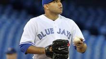 Toronto Blue Jays pitcher Ricky Romero pauses on the mound during the first inning of their American League baseball game against the Seattle Mariners in Toronto September 12, 2012. (MIKE CASSESE/REUTERS)