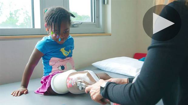 A child gets treated for a leg injury