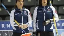 Nova Scotia vice-skip Colleen Jones, left, and skip Mary-Anne Arsenault study a shot during eighth draw curling action against the Northwest Territories at the Scotties Tournament of Hearts Tuesday, February 19, 2013 in Kingston, Ont. (Ryan Remiorz/THE CANADIAN PRESS)