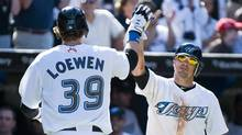 Toronto Blue Jays Adam Loewen is congratulated by Mike McCoy after hitting a home run against the Baltimore Orioles during seventh inning MLB action in Toronto on Sunday September 11, 2011. (Aaron Vincent Elkaim)