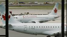 Air Canada planes sit on the tarmac at Pearson International Airport in Toronto, June 17, 2008. (MIKE CASSESE/REUTERS)