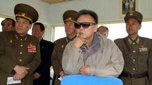 North Korean leader Kim Jong-il, centre, is seen in an undated file photo released by Korean Central News Agency on Friday, May 22, 2009.