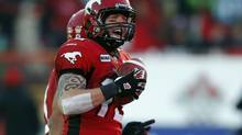 Calgary Stampeders' quarterback Bo Levi Mitchell celebrates his touchdown against the Saskatchewan Roughriders during the second half of their West Division semi-final CFL football game in Calgary, Alberta, November 11, 2012. (TODD KOROL/REUTERS)