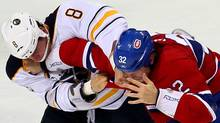 Buffalo Sabres centre Cody McCormick (8) and Montreal Canadiens left wing Travis Moen (32) fight during the second period at the Bell Centre. Jean-Yves Ahern-US PRESSWIRE (Jean-Yves Ahern-US PRESSWIRE/Jean-Yves Ahern)