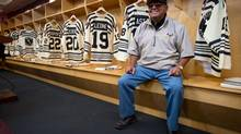 "Fred Sasakamoose, a residential school survivor and the first First Nations NHL hockey player, sits in the Vancouver Giants dressing room where the WHL hockey team unveiled First Nations tribute jerseys in Vancouver, Sept. 19, 2013. The jerseys feature the ""lazy cross"", the brand of the Alkali Lake Ranch where most players on the Alkali Lake Braves hockey team worked. Sasakamoose played for the Chicago Blackhawks in 1954. The Giants will wear the jerseys on Friday when they open their season against the Victoria Royals. (DARRYL DYCK FOR THE GLOBE AND MAIL)"