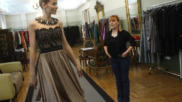 Hungarian fashion designer Kati Zoob, right, inspects a model wearing her creation in Budapest. Around emerging Europe, where garment assembly for Western brands has been a thriving business for years, there is a new confidence that local designs also have a chance on the world stage. (BERNADETT SZABO/REUTERS)