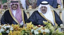 In this Tuesday, Nov. 1, 2011 file photo, Saudi's Crown Prince - Interior minister Nayef bin Abdul-Aziz, right, and his son, deputy to the Saudi Interior Minister, Prince Mohammed bin Nayef, attend a ceremony of the Saudi armed forces, as they prepare for the influx of people to participate in the annual Hajj, in Arafat 15 kilometers outside of Mecca, Saudi Arabia. The Saudi royal family said Saturday, June 16, 2012 that Crown Prince Nayef has died. He was in his late 70s. Peince Nayef was the hard-line interior minister who spearheaded Saudi Arabia's fierce crackdown crushing al-Qaeda's branch in the country and then rose to become next in line to the throne. (Hassan Ammar/AP)