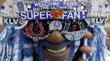 "Football fan Michael Hopson is dressed as ""Super Fan"" as he walks in Super Bowl Village, Friday, Feb. 3, 2012, in Indianapolis, Ind. The New England Patriots are scheduled to face the New York Giants in NFL football Super Bowl XLVI on Feb. 5. (AP Photo/Mark Humphrey) (Mark Humphrey)"