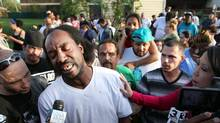 Neighbour Charles Ramsey speaks to media near the home on the 2200 block of Seymour Avenue, where three missing women were rescued in Cleveland on May 6, 2013. (Scott Shaw/AP)