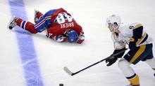 Montreal Canadiens forward Daniel Briere (48) lays on the ice after colliding with Nashville Predators forward Eric Nystrom (not pictured) during the second period at the Bell Centre. (Eric Bolte/USA Today Sports)