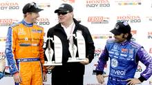 Charlie Kimball, left, celebrates winning the Honda Indy 200 at Mid-Ohio Sports Car Course with car owner Chip Ganassi, centre, and teammate and third place finisher Dario Franchitti, right, of Scotland, in Lexington, Ohio Sunday, August 4, 2013. (Tom E. Puskar/AP Photo)