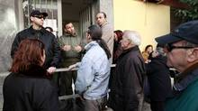 People line up outside a Social Welfare office, in order to advance their procedure to take a welfare allowance, at Egaleo suburb in the west of Athens February 17, 2012. (JOHN KOLESIDIS/JOHN KOLESIDIS/REUTERS)