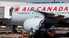 An Air Canada Boeing 777 is refuelled at Sydney airport in this July 28, 2011 file photo. Thanks to extra fuel left on their plane and a pair of binoculars from a passenger, the crew of an Air Canada jetliner helped in the rescue of a sailor adrift in the South Pacific. (Tim Wimborne/Reuters)