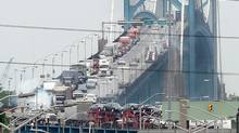 Traffic backs up on the Canadian side Ambassador bridge between Windsor, Ont., and Detroit in this 2006 file photo. (Jason Kryk/The Canadian Press/CP)