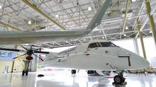 A Bombardier Q400 jet sits in a hangar at the Bombardier facility in Toronto, Ontario on Wednesday July 25, 2012. (Aaron Vincent Elkaim/THE CANADIAN PRESS)
