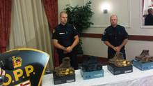 OPP officers present the style of boots that they say may help them find the killer of an Orangeville woman.