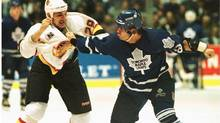 Returning to his first game after an eight game suspension, Toronto Maple Leafs' Tie Domi (R) prepares to deliver a punch to Vancouver Canucks' Gino Odjick during first period NHL action in Vancouver, November 3, 1995. (Jeff Vinnick/REUTERS)