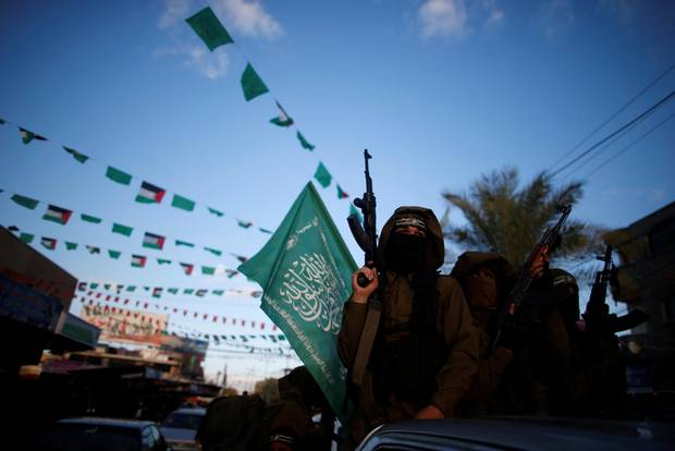Palestinian Hamas militants take part in a protest in the northern Gaza Strip.