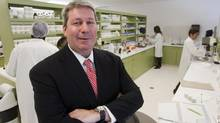Valeant Pharmaceuticals International Inc. CEO Michael Pearson is seen in one of the company's laboratories in Laval. (Ryan Remiorz/THE CANADIAN PRESS)